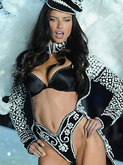Adriana Lima busts in lingerie on the runway