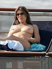 Elizabeth Hurley caught sunbathing topless