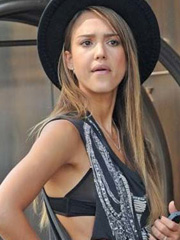 Jessica Alba giving us some nice bra peek