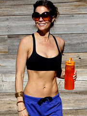 Brooke Burke sexy and busty in sports bra