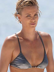 Charlize Theron hot bikini shoot on the beach