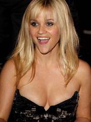 Reese Witherspoon boobs pop out of her dress