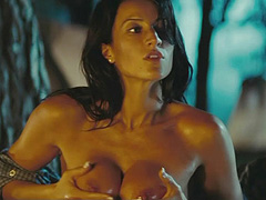 America Olivo massages her huge breasts