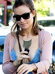 Olivia Wilde braless flashes nice cleavage