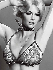 Kate Upton busts out hot cleavage in lingerie