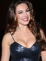Kelly Brook busts out her birthday cleavage