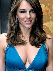 Elizabeth Hurley drops massive cleavage