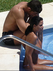 Katie Price caught topless while she sunbathing