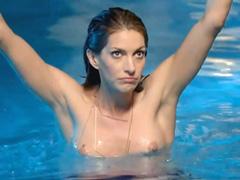 Dawn Olivieri topless in a swimming pool