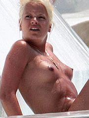 Lily Allen nipple slip and topless cliff jumping