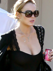 Lindsay Lohan lets her huge breasts out