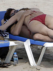 Heather Graham in bikini hanging out with a guy