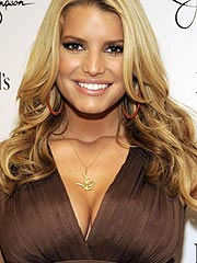 Jessica Simpson great smelling cleavage in dress