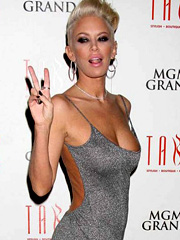 Jenna Jameson boobs pop out of sexy dress