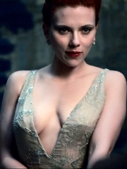 Scarlett Johansson busts braless cleavage