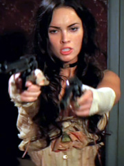 Megan Fox shows cleavage legs and guns
