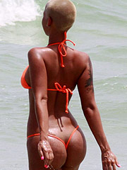 Amber Rose exposing marble ass in thong bikini