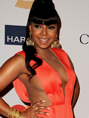 Ashanti braless busts out awesome cleavage