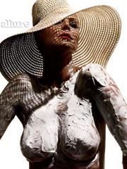 Heidi Klum topless posing in magazine
