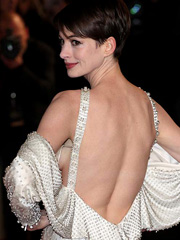 Anne Hathaway flashes sideboob at the premiere