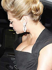 Kate Upton busts out her massive cleavage