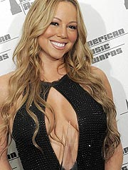 Mariah Carey big cleavage in open black shirt
