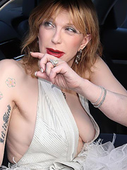 Courtney Love oops flashes off boob slip