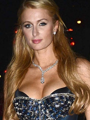 Paris Hilton busting her pushed up cleavage