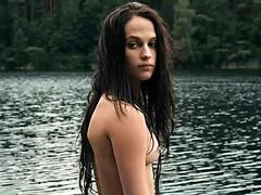 Alicia Vikander naked dives into a lake