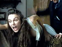 Keira Knightley bent over as a guy spanks her