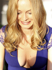 Heather Graham lets her big breasts fall out