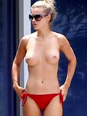 Joanna Krupa topless and bikini poolside shots
