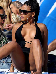 Christina Milian boobs pop out of swimsuit