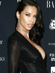 Adriana Lima shows of deep cleavage