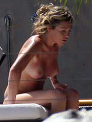 Abigail Clancy topless and squeezed tits in bikini