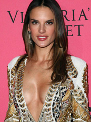 Alessandra Ambrosio drops braless cleavage