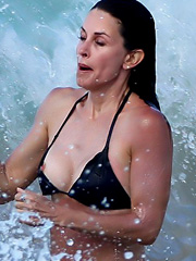 Courteney Cox oops nipple slip in a bikini