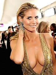 Heidi Klum oops boobs fall out of dress