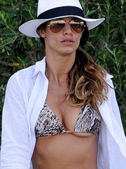 Elisabetta Canalis boobs bust out of a bikini top