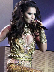 Cheryl Cole flashes busty cleavage at stage