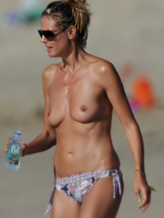 Heidi Klum oops topless caught on the beach
