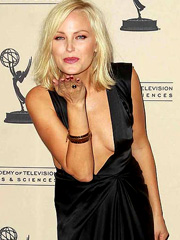 Malin Akerman lets her breasts hang out