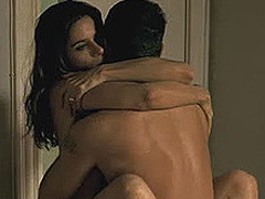 Amanda Peet is wrapped naked around a guy