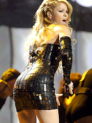 Shakira exposes her booty  in a sexy dress
