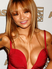 Tila Tequila big cleavage saves her face