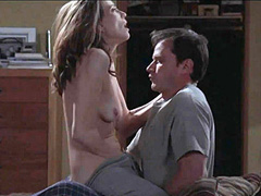 Ally Walker topless riding a guy in bed