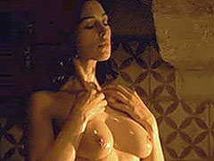 Monica Bellucci topless as she leans over a bowl