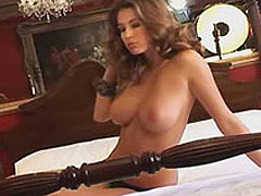 Keeley Hazell strip off her clothes to go topless