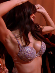 Adriana Lima cleavage in hot little dress