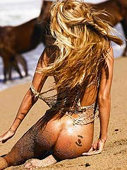 Jenna Jameson nude on beach with sand on her ass